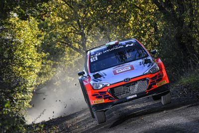Hyundai Motorsport customer racing rally car i20 R5 in action from the front.