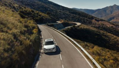 The Hyundai IONIQ driving on a hilly slope