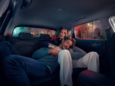 A couple cuddling in a Hyundai KONA Electric