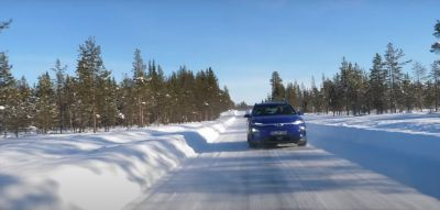 Hyundai KONA Electric driving in snow and cold weather