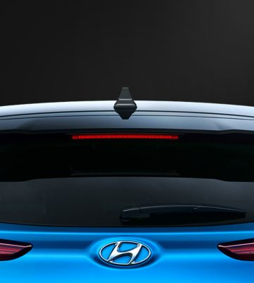 The new Hyundai KONAHybrid pictured from the rear, highlighting the rear spoiler.