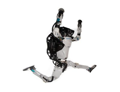 Image of a Boston Dynamics robot, jumping in the air.