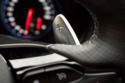 close-up of the racing-inspired paddle shifters on the steering wheel on the new Hyundai i30 Fastback N