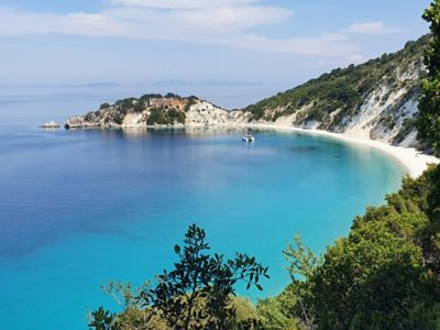 An ocean bay in Ithaca, Greece withturquoise-coloured water.