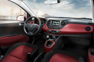 Wide-angle view of the Hyundai i10's driver's seat, with easily-reachable controls.