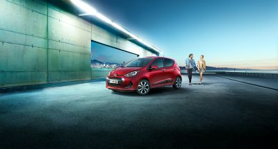 The Hyundai i10, pictured from the side in a futuristic setting.