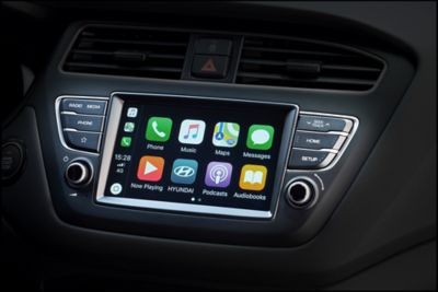 "Photo of the 7"" touch screen featuring Apple CarPlay™ in the Hyundai i20 Coupe."