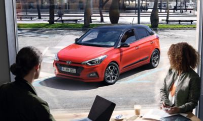 Side view of the new Hyundai i20 parking on a street.