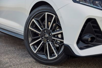 The front wheels on the Hyundai i20 N Line with their stylish two-tone finish.