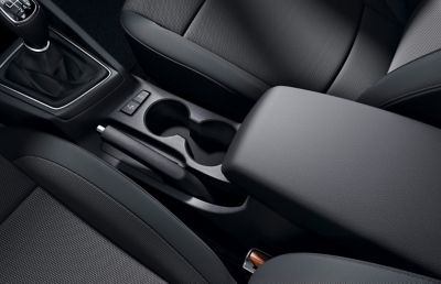 Close up view of the centre console and armrest  in the Hyundai i20 Coupe.