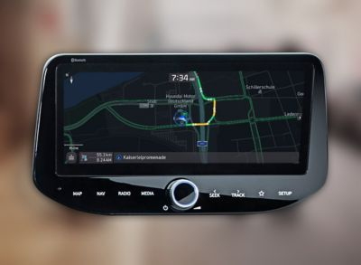 Close-up of a Hyundai touchscreen showing navigation with live traffic information.
