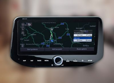 Close-up of a Hyundai touchscreen showing navigation with connected routing.