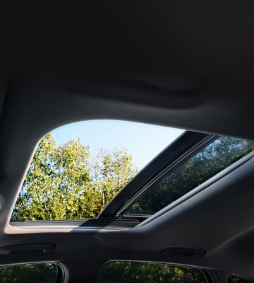 Hyundai i30 Fastback N pictured with the sunroof open with a view of the trees outside.