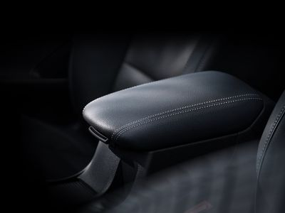 A close up view of the sliding front armrest in the new Hyundai i30 Fastback.