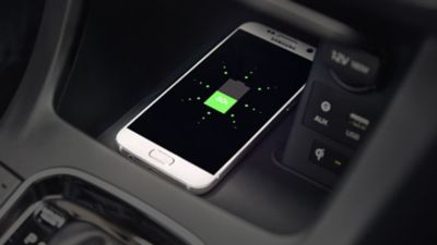 Close up view of the centrally located wireless charging pad in the Hyundai i30.
