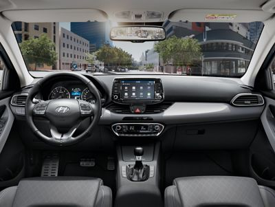 A photo showing the sporty interior of the new Hyundai i30 featuring a 8 inch touch screen.