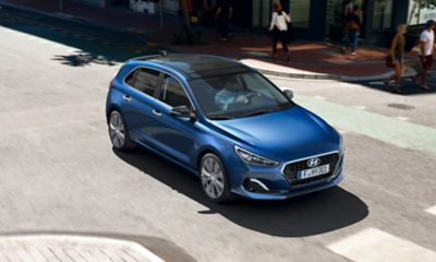 Side view of the new Hyundai i30 driving on a street.