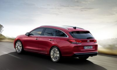 Photo of the new Hyundai i30 Wagon driving on a road.