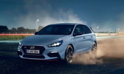 The Hyundai i30 N starting off at a race track with smoking tyres.