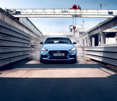 The Hyundai i30 N from the front in an industrial landscape.