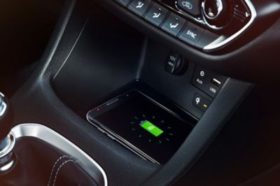 Close up view of the centrally located wireless charging pad in the Hyundai i30 N .