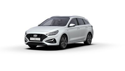 Vista frontal y lateral del nuevo Hyundai i30 en color Polar White.