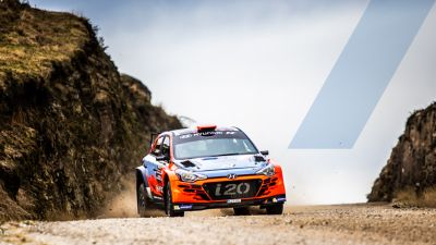Hyundai Motorsport customer racing rally car i20 R5 in action on a gravel road.