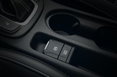 Vista en detalle del freno de aparcamiento eléctrico del Hyundai KONA Híbrido eléctrico.