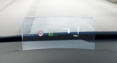 Ilustración de la alerta de límite de velocidad del Hyundai KONA Híbrido eléctrico.