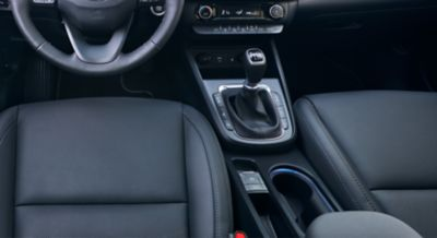 Close-up of the centre console inside the new Hyundai Kona, focused on the electric parking brake