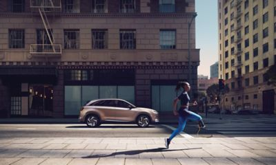 Athlete Femita Ayanbeku running past an all-new Hyundai Nexo.