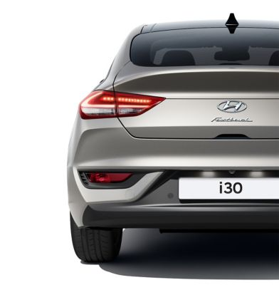 The new Hyundai i30 Fastback pictured from the rear, focused on the rear combination lamps.