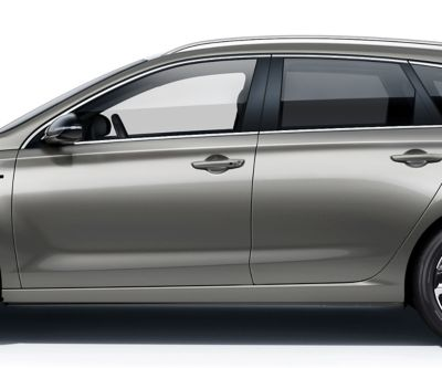 The new Hyundai i30 Wagon pictured from the driver side, focused on the doors roof, windows, and doors