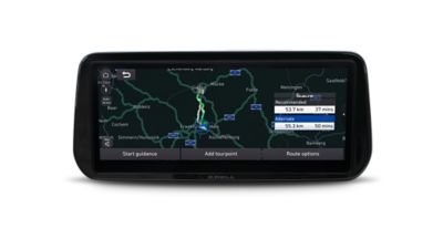 Close-up of the all-new Hyundai Santa Fe Hybrid AVN touchscreen with navigation system on screen