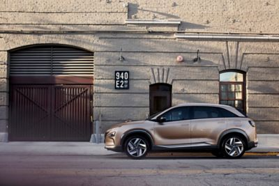Hyundai NEXO Fuel Cell Electric Vehicle parked on a city street.