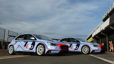 Photo of two Hyundai i30 N TCR vehicles.