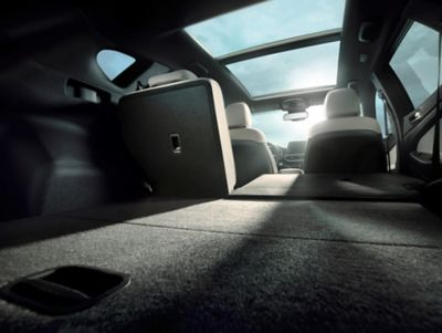 View of the Hyundai Tucson's boot with one seat folded down.