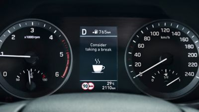Vehicle dashboard showing the suggestion to take a break.