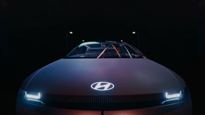A Hyundai electric vehicle concept pictured from the front with Panoramic Pixel LED headlights.