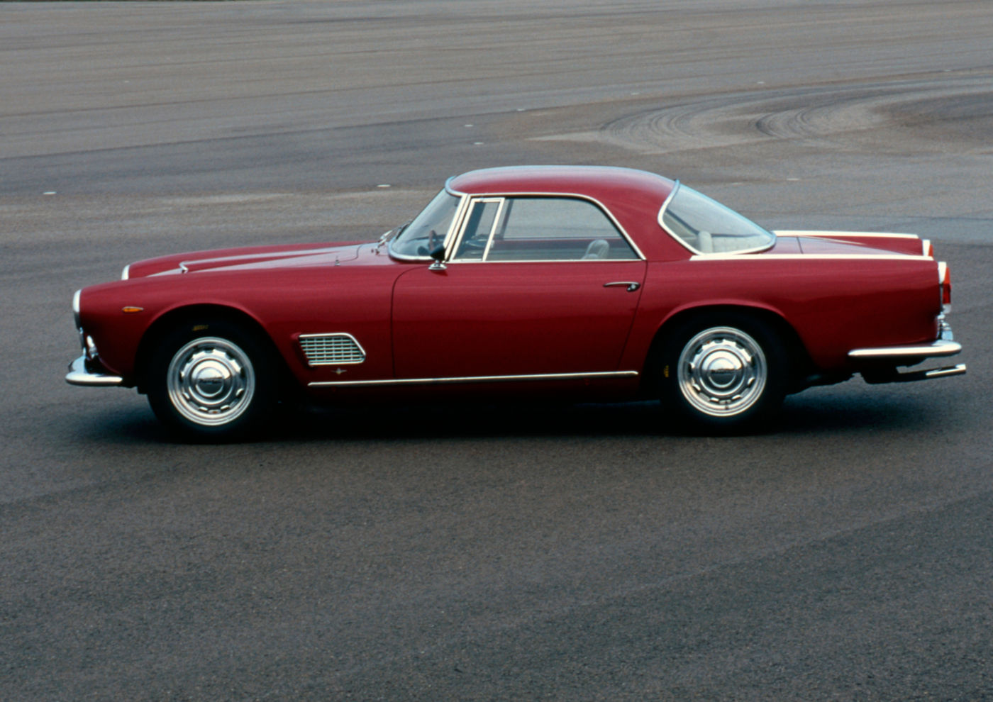 1957 Maserati 3500GT - side view of a red classic car model
