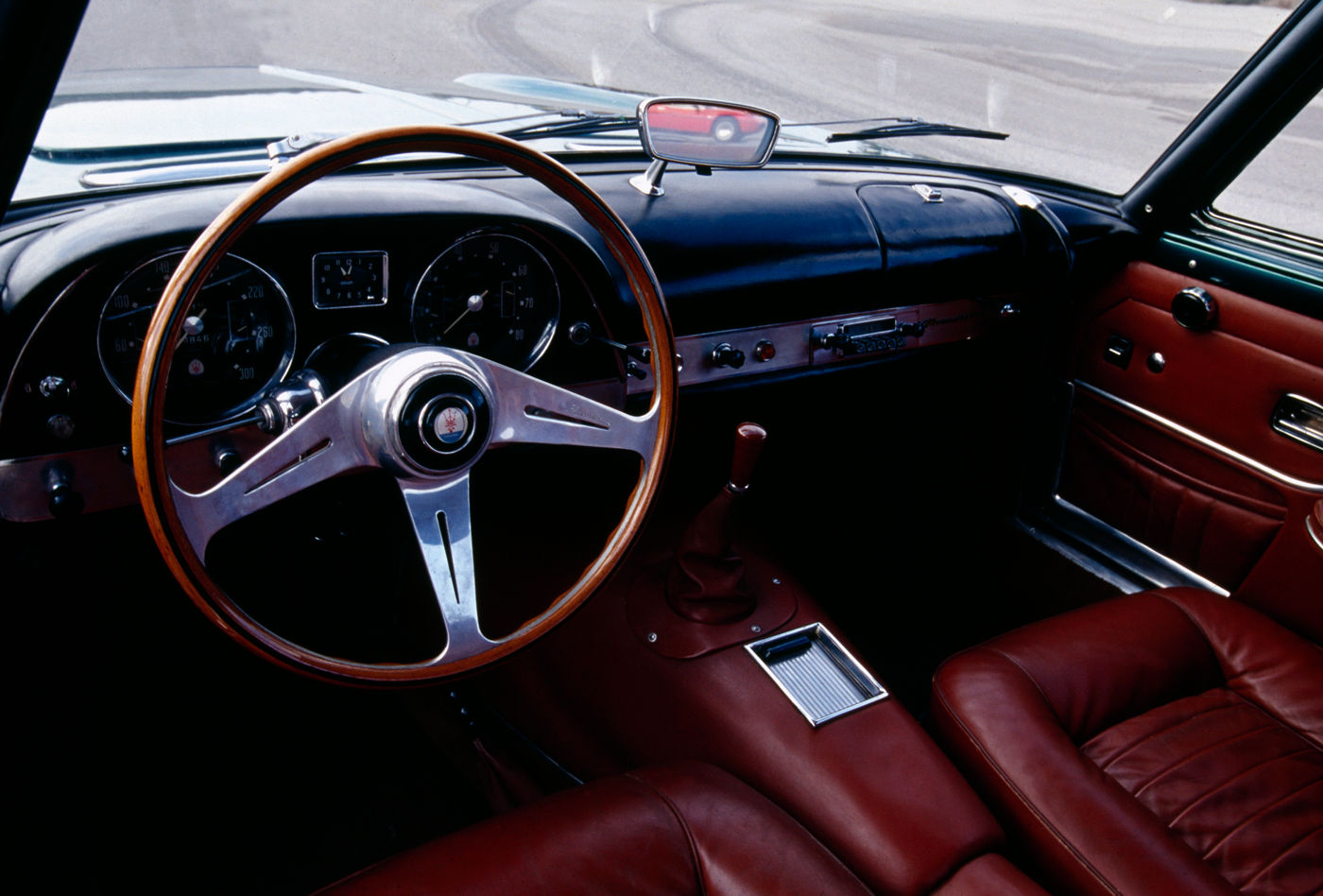 1957 Maserati 5000 GT - interior view of the classic car model in blue