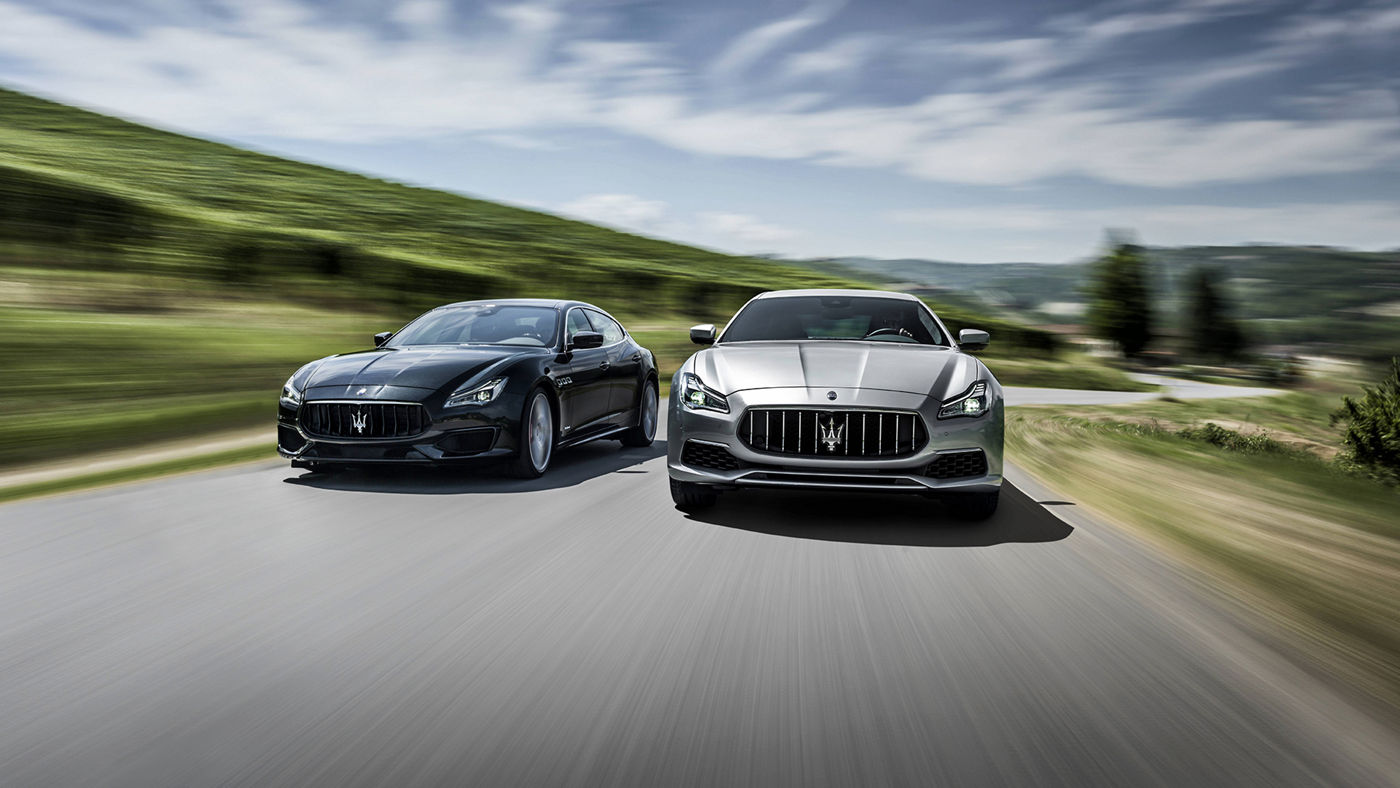 Black and grey Maserati Quattroporte - Front view - On the road