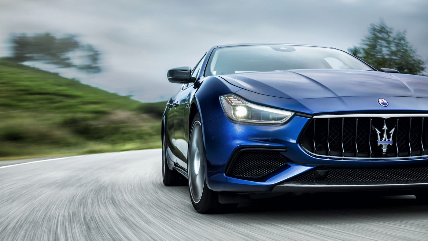 A Maserati Ghibli GranSport on the road - front view close up