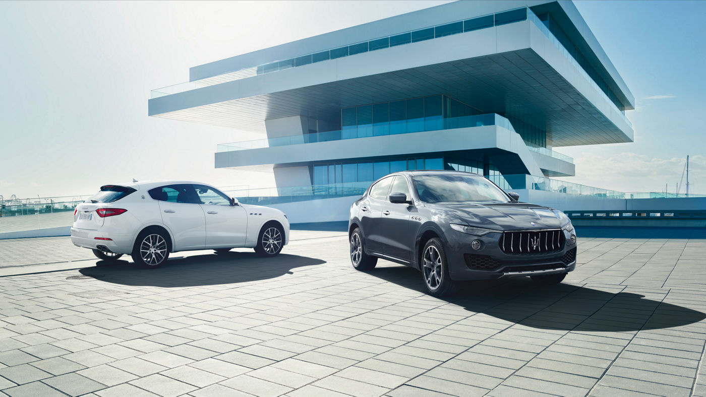 Black and white Maserati Levante - Luxury SUV - Side view