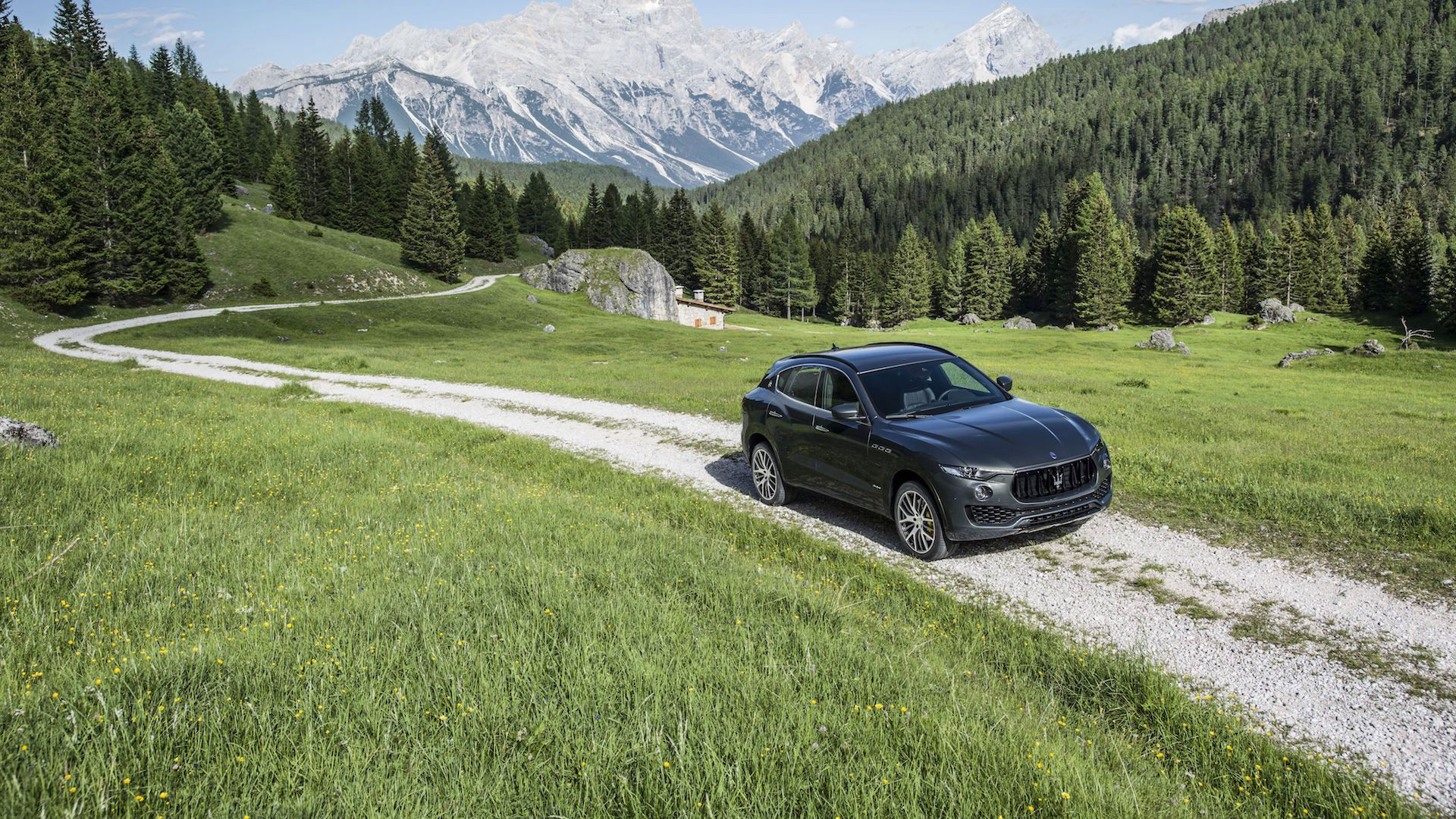 Maserati Levante driving in a mountains landscape - air suspension technology