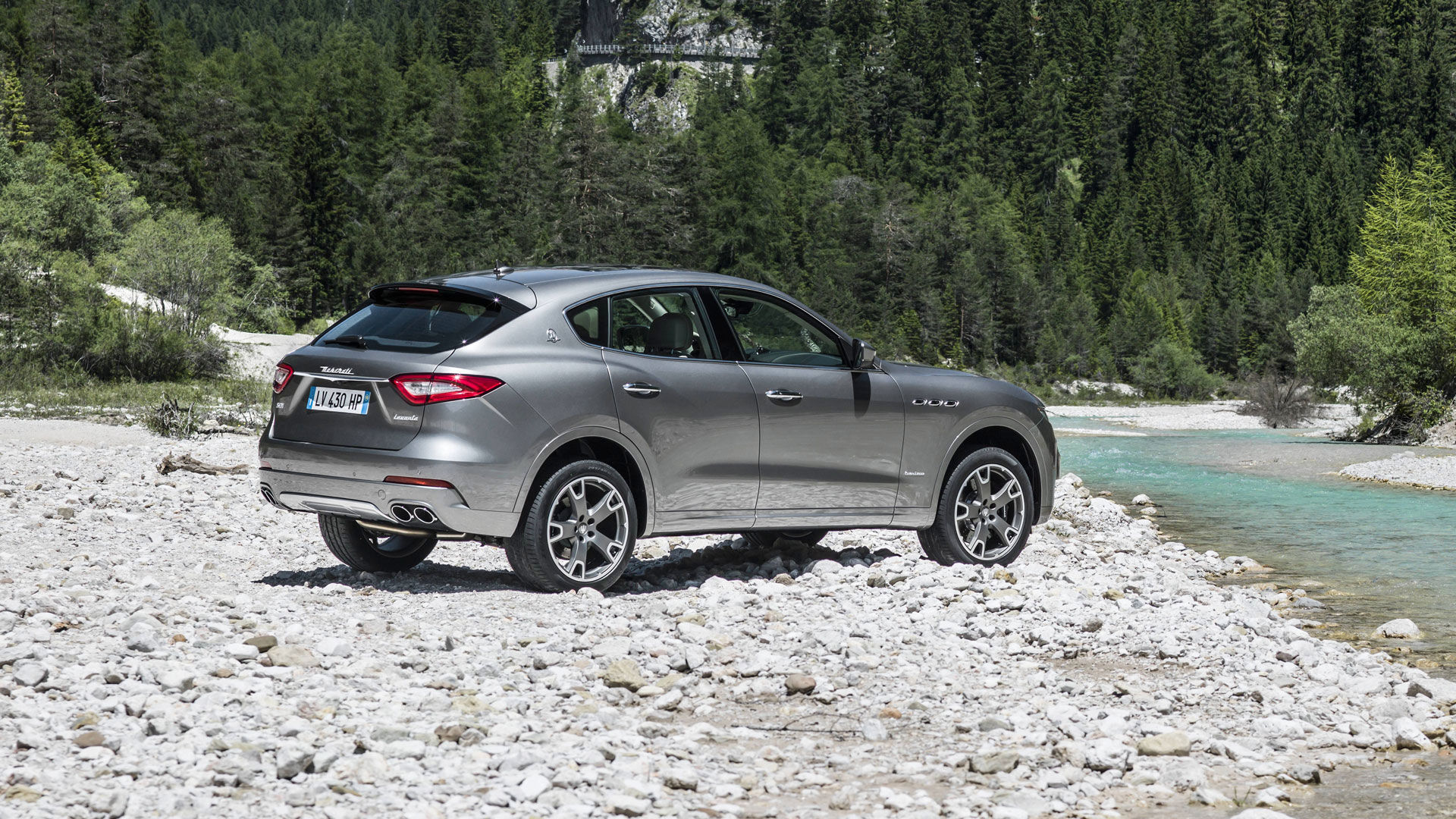 Maserati Levante grey - rear and side view- river landscape perspective
