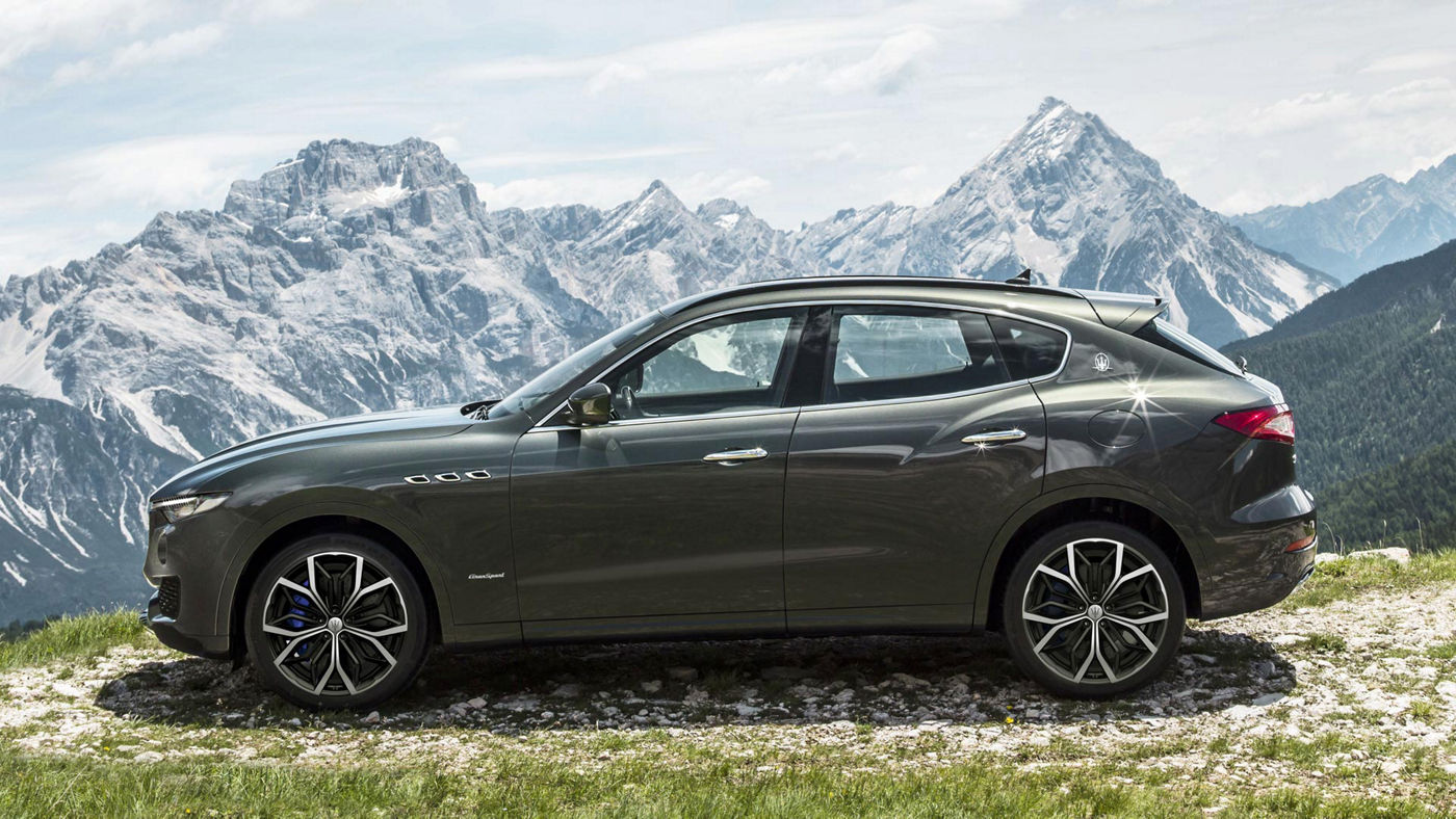 Grey Maserati Levante - Luxury SUV - Side view - On the road