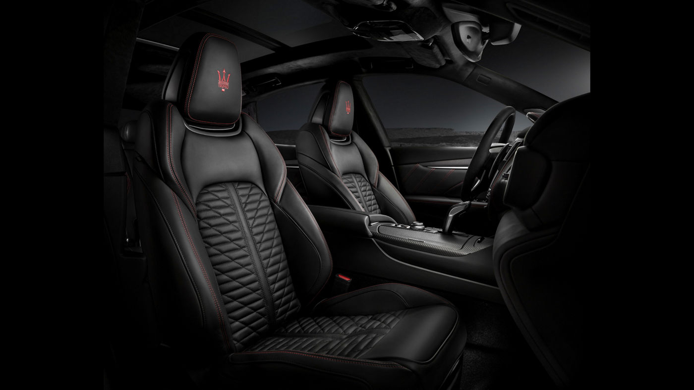 Maserati Levante Trofeo V8 interiors: dashboard, steering wheel, front seats in black leather and red stitching