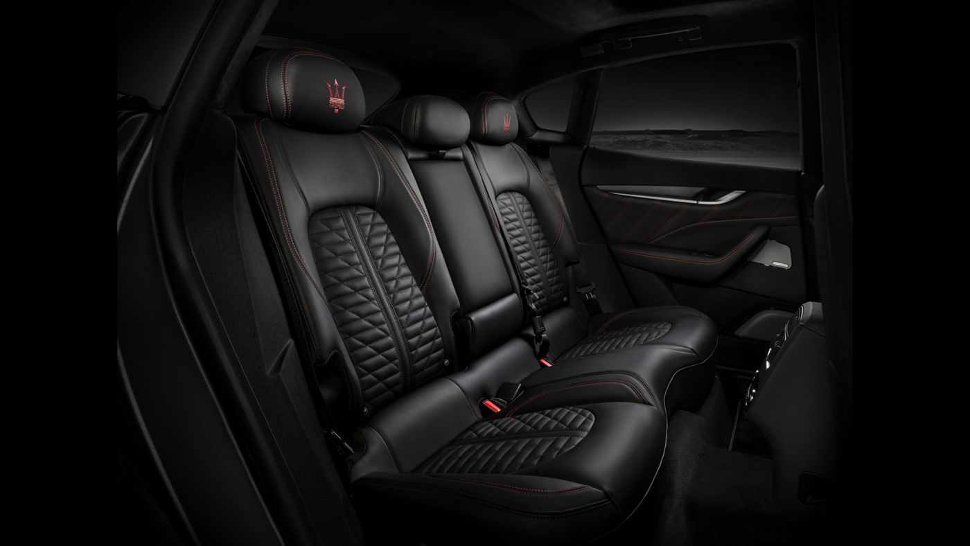 Maserati Levante Trofeo V8 - interior details: rear seats with black leather and red stitching