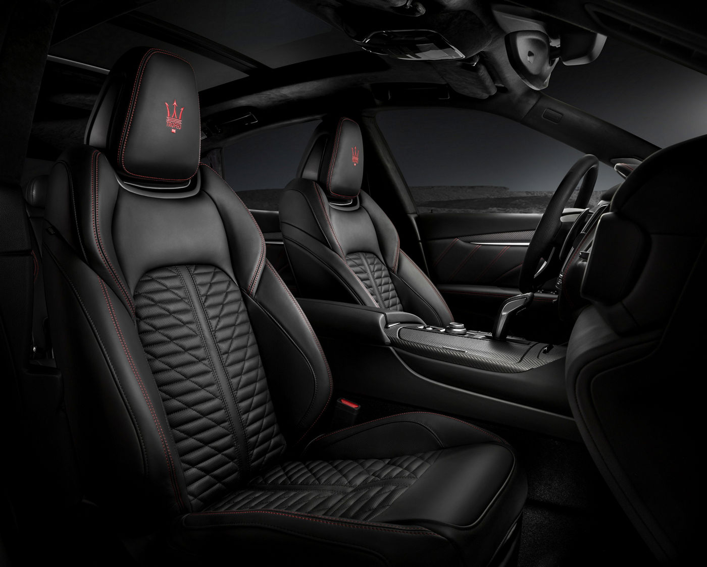 Maserati Levante Trofeo - interior details: dashboard, steering wheel, front seats in black leather and red stitchings